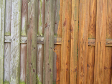 Before and after powerwashed fence